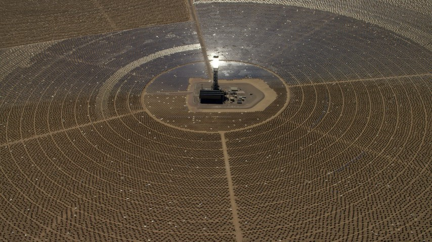 Looking down at one of the solar power structures at the Ivanpah Solar Electric Generating System in California Aerial Stock Footage | FG0001_000211
