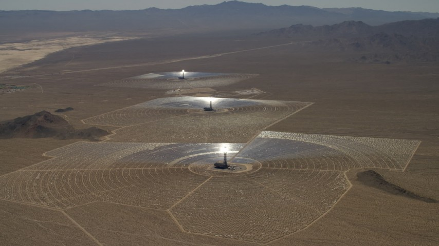Tilt to reveal the solar power structures at the Ivanpah Solar Electric Generating System in California Aerial Stock Footage | FG0001_000212