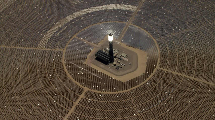 Tilt to bird's eye of one of the solar power structures at the Ivanpah Solar Electric Generating System in California Aerial Stock Footage | FG0001_000214
