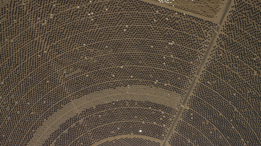 A bird's eye of one of the mirror arrays at the Ivanpah Solar Electric Generating System in California Aerial Stock Footage FG0001_000216