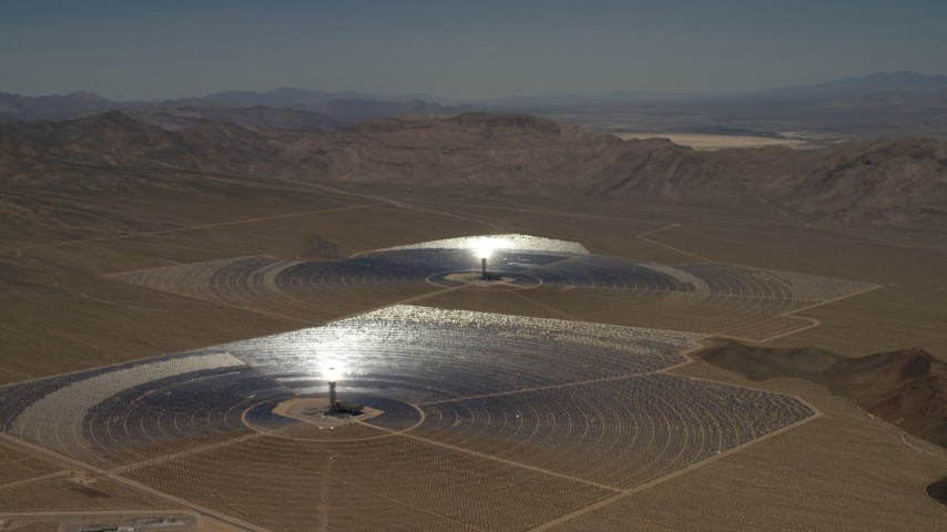 Two of the mirror arrays and power towers at the Ivanpah Solar Electric Generating System in California Aerial Stock Footage | FG0001_000221