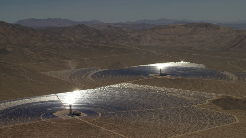 A pair of mirror arrays and power towers at the Ivanpah Solar Electric Generating System in California Aerial Stock Footage FG0001_000222