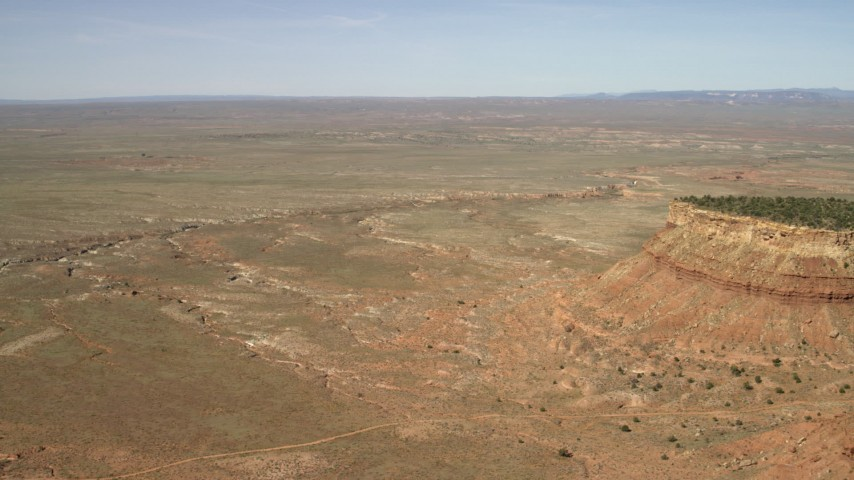 4K stock footage aerial video approach a dry riverbed running through the Arizona Desert Aerial Stock Footage | FG0001_000227