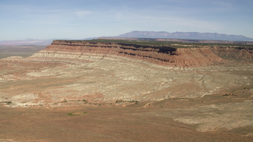 4K stock footage aerial video of a mesa seen across a desert plain in the Arizona Desert Aerial Stock Footage | FG0001_000229