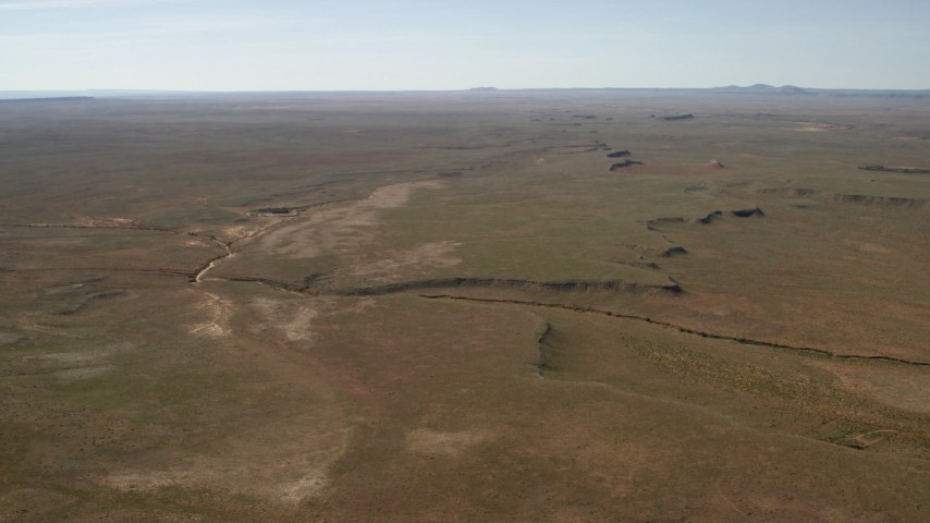 4K stock footage aerial video of a dry riverbed and a desert plain in the Arizona Desert Aerial Stock Footage | FG0001_000230