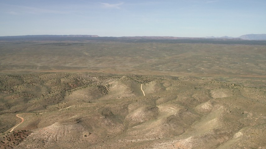 4K stock footage aerial video tilt from a bird's eye view of mesas to reveal a wide plain in the Arizona Desert Aerial Stock Footage | FG0001_000237