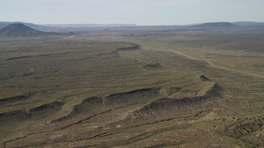 4K stock footage aerial video flyby a mesa overlooking desert road and plain in the Arizona Desert Aerial Stock Footage | FG0001_000238