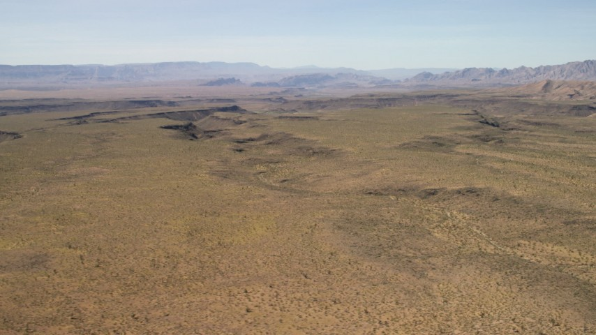 4K stock footage aerial video of a wide plain and canyons in the Arizona Desert Aerial Stock Footage   FG0001_000246