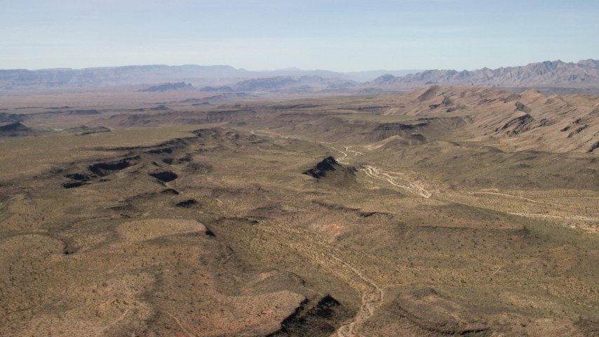 4K stock footage aerial video of a wide canyon through the desert plain in the Arizona Desert Aerial Stock Footage | FG0001_000248