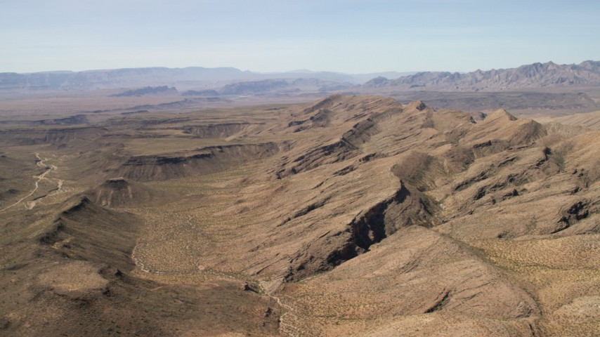 4K stock footage aerial video of a wide canyon through the desert by mountains in the Arizona Desert Aerial Stock Footage   FG0001_000249