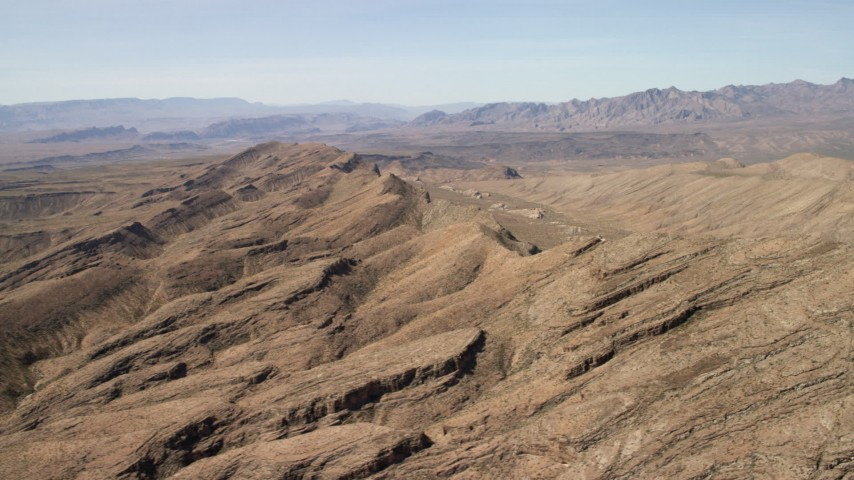 4K stock footage aerial video flyby mountains to reveal a wide canyon in the Arizona Desert Aerial Stock Footage   FG0001_000250