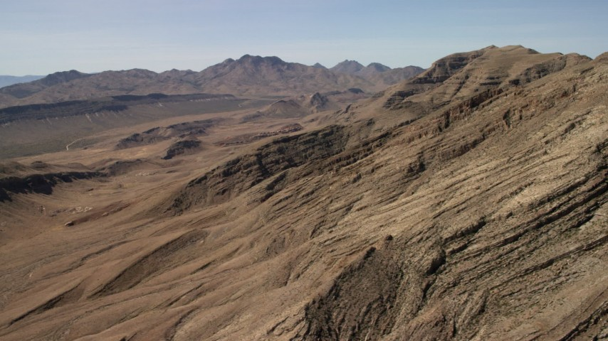 Flyby rough desert mountains in the Nevada Desert Aerial Stock Footage FG0001_000255