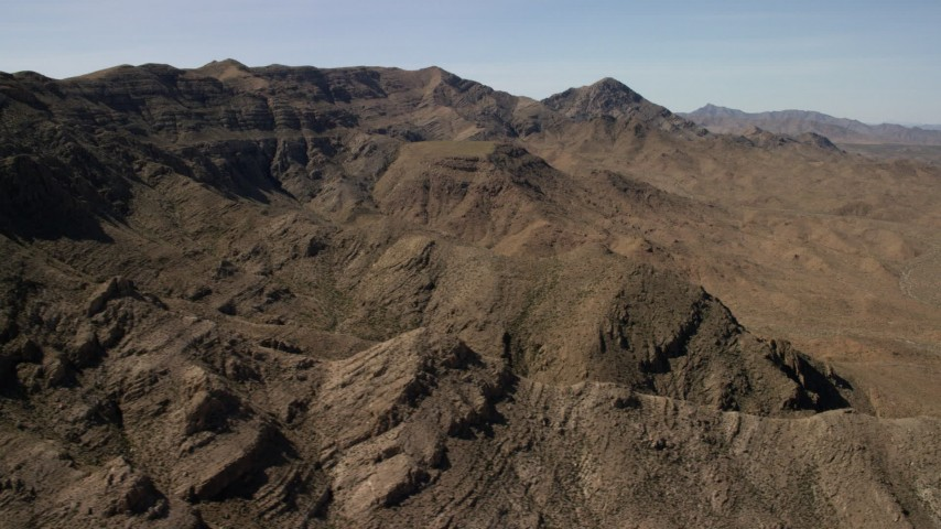 Flyby a rocky mountain ridge in the Nevada Desert Aerial Stock Footage | FG0001_000257