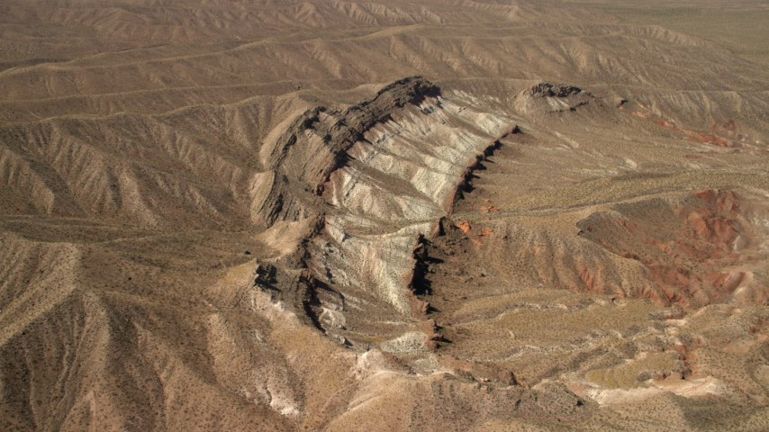 4K stock footage aerial video approach a scarred hillside in the Nevada Desert Aerial Stock Footage | FG0001_000265