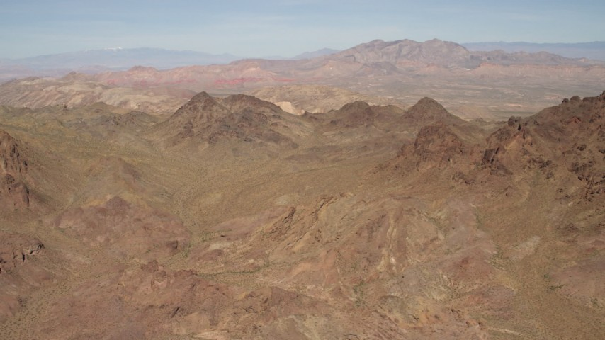 4K stock footage aerial video flyby rugged, barren mountains in the Nevada Desert Aerial Stock Footage | FG0001_000282