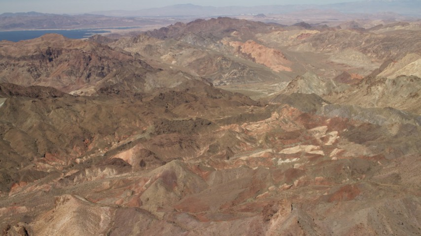 4K stock footage aerial video fly over rugged, barren mountains near Lake Mead in the Nevada Desert Aerial Stock Footage | FG0001_000285