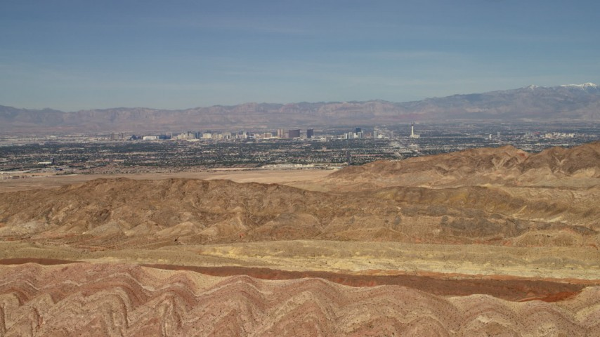 4K stock footage aerial video fly over barren desert mountains to approach Las Vegas, Nevada Aerial Stock Footage | FG0001_000302