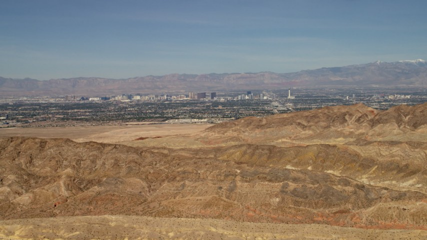 4K stock footage aerial video of a view of Las Vegas, Nevada from barren desert mountains Aerial Stock Footage | FG0001_000303