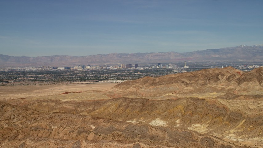 4K stock footage aerial video of Las Vegas, Nevada seen from barren desert mountains outside the city Aerial Stock Footage | FG0001_000304