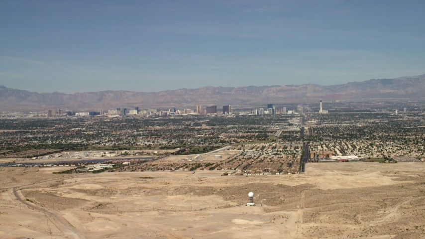 4K stock footage aerial video fly over a desert mountain to reveal the city of Las Vegas, Nevada Aerial Stock Footage | FG0001_000306
