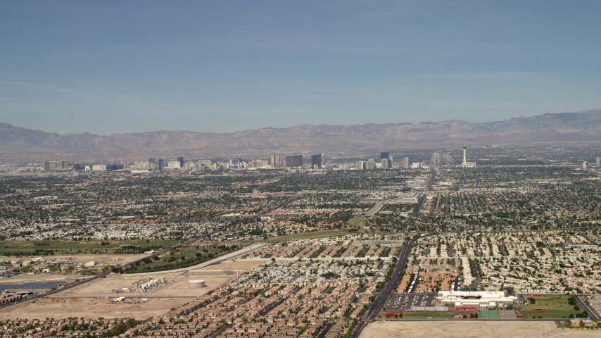 4K stock footage aerial video of Las Vegas hotels and casinos seen from suburban neighborhoods, Nevada Aerial Stock Footage | FG0001_000308