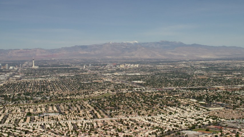 4K stock footage aerial video fly over suburban neighborhoods to approach the downtown area of Las Vegas, Nevada Aerial Stock Footage | FG0001_000309