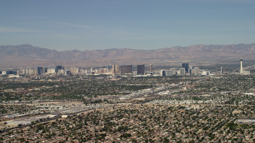 4K stock footage aerial video of Las Vegas hotels and casinos seen from suburban neighborhoods, Nevada Aerial Stock Footage | FG0001_000310