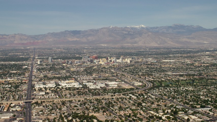 4K stock footage aerial video of Downtown Las Vegas hotels and casinos seen from I-515 and suburban neighborhoods, Nevada Aerial Stock Footage | FG0001_000311