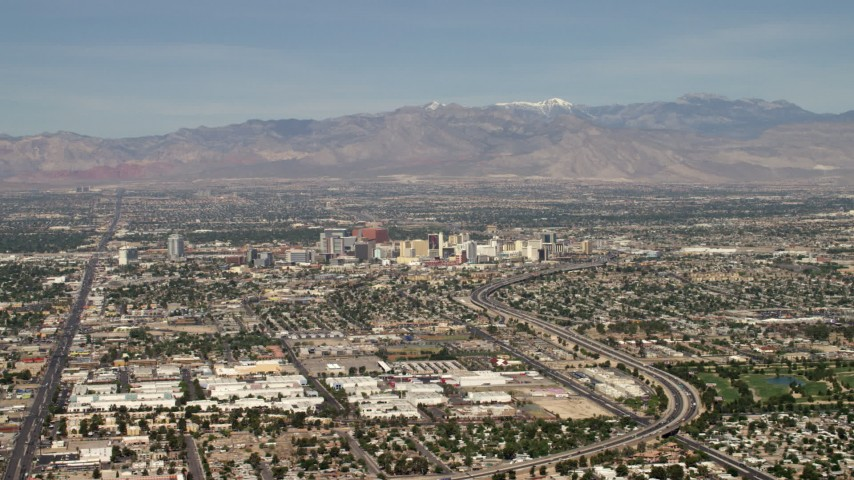 4K stock footage aerial video approach Downtown Las Vegas hotels and casinos from I-515, Nevada Aerial Stock Footage | FG0001_000312