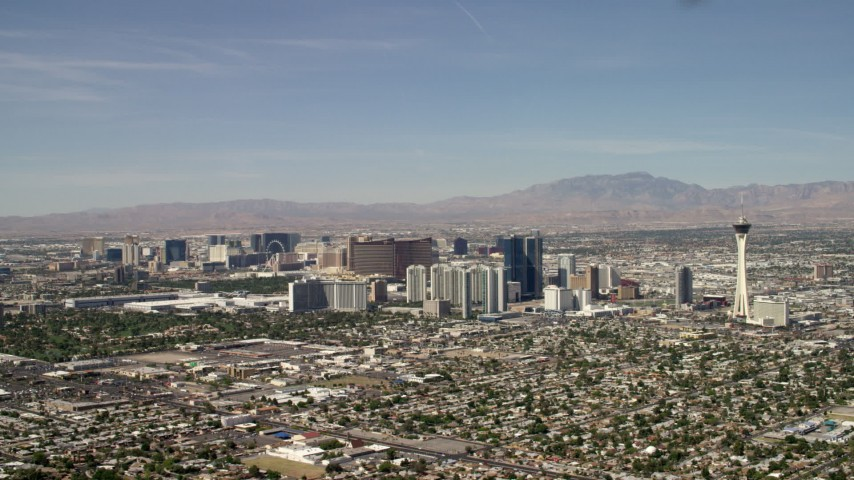 Hotels and casinos on the Las Vegas Strip seen from near Stratosphere, Nevada Aerial Stock Footage | FG0001_000316