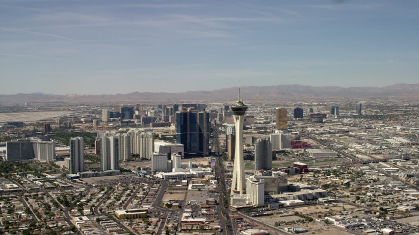 Flyby Stratosphere with a view of hotels and casinos on the Las Vegas Strip in Nevada Aerial Stock Footage | FG0001_000318