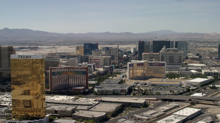4K stock footage aerial video of Las Vegas Strip resort casinos seen while passing Treasure Island and The Mirage in Nevada Aerial Stock Footage | FG0001_000323