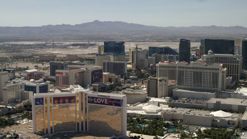 4K stock footage aerial video of The Mirage, Flamingo, Paris Las Vegas, and Caesar's Palace on the Las Vegas Strip in Nevada Aerial Stock Footage | FG0001_000324