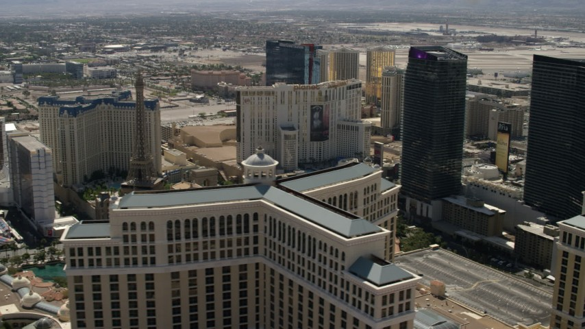 4K stock footage aerial video of Paris Las Vegas and Planet Hollywood seen from the Bellagio, The Cosmopolitan, and reveal Aria on the Las Vegas Strip in Nevada Aerial Stock Footage FG0001_000326 | Axiom Images