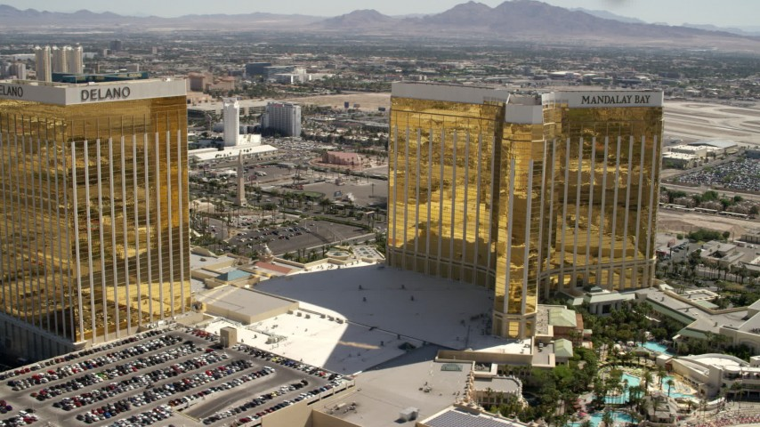 4K stock footage aerial video flyby the Delano and Mandalay Bay, and reveal Luxor between them on the Las Vegas Strip, Nevada Aerial Stock Footage | FG0001_000329