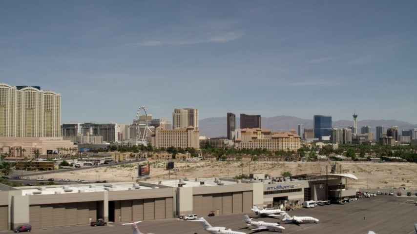 4K stock footage aerial video of lifting off from McCarran Airport to focus on casino resorts on the Las Vegas Strip, Nevada Aerial Stock Footage | FG0001_000333