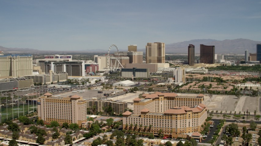 Approach and pan across casino resorts on the Las Vegas Strip, Nevada Aerial Stock Footage | FG0001_000334