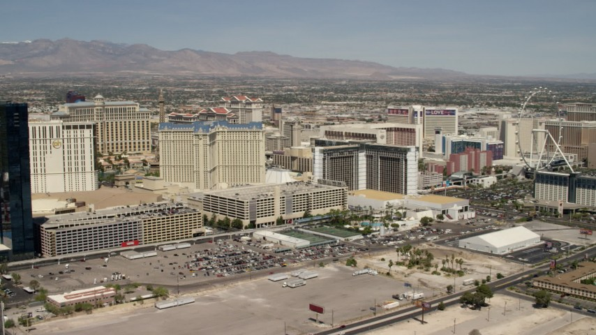 4K stock footage aerial video pan across casino resorts on the Las Vegas Strip, Nevada, to focus on Planet Hollywood and Paris Las Vegas Aerial Stock Footage | FG0001_000335