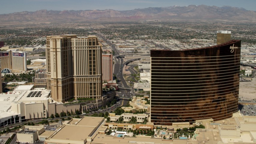 4K stock footage aerial video flyby the the Palazzo to reveal the Wynn and Encore casino resorts on the Las Vegas Strip, Nevada Aerial Stock Footage | FG0001_000338