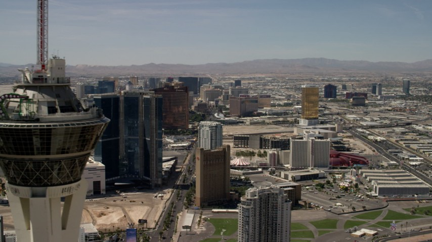 4K stock footage aerial video flyby the top of Stratosphere Las Vegas, Nevada, and focus on casino resorts on the Las Vegas Strip Aerial Stock Footage | FG0001_000342