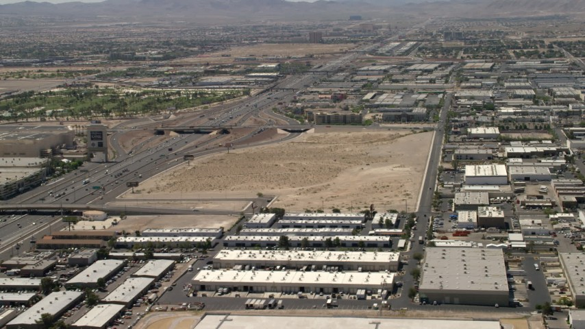 4K stock footage aerial video of the future site of the Las Vegas Raiders stadium and the 15 freeway in Las Vegas, Nevada Aerial Stock Footage | FG0001_000349