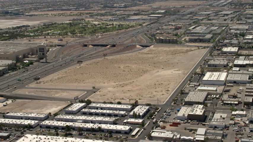 4K stock footage aerial video of the future site of the Las Vegas Raiders stadium and the 15 freeway in Las Vegas, Nevada Aerial Stock Footage   FG0001_000349