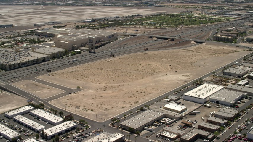 4K stock footage aerial video future site of the Las Vegas Raiders stadium beside I-15 with light traffic in Las Vegas, Nevada Aerial Stock Footage | FG0001_000350