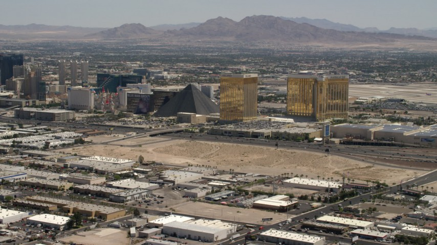 4K stock footage aerial video of Vegas Strip casino resorts across I-15 from an open dirt lot in Las Vegas, Nevada Aerial Stock Footage | FG0001_000353