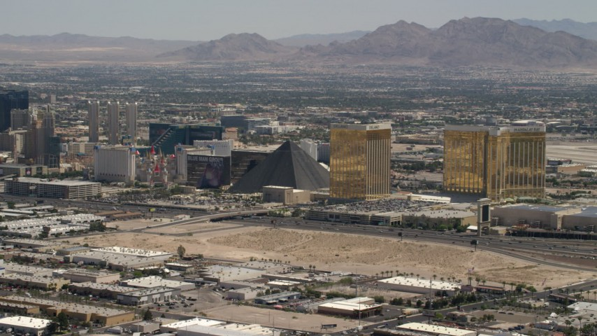 4K stock footage aerial video of Las Vegas Strip casino resort hotels across I-15 from an open dirt lot in Las Vegas, Nevada Aerial Stock Footage | FG0001_000354