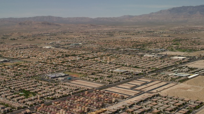 4K stock footage aerial video fly over neighborhoods with tract homes and approach an elementary school in Las Vegas, Nevada Aerial Stock Footage | FG0001_000356