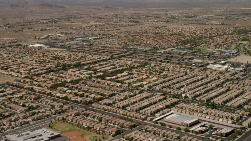 4K stock footage aerial video fly over neighborhoods with tract homes and approach apartment buildings in Las Vegas, Nevada Aerial Stock Footage | FG0001_000357