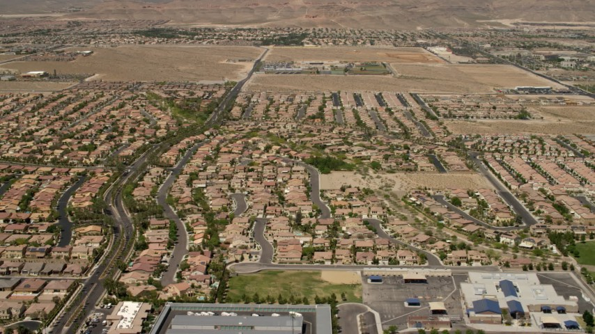 4K stock footage aerial video fly over and pan across neighborhoods with tract homes and apartment buildings in Las Vegas, Nevada Aerial Stock Footage FG0001_000358 | Axiom Images