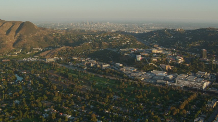 1080 stock footage aerial video Universal Studios Hollywood and Downtown Los Angeles skyline, Universal City, California, sunset Aerial Stock Footage | HDA06_04