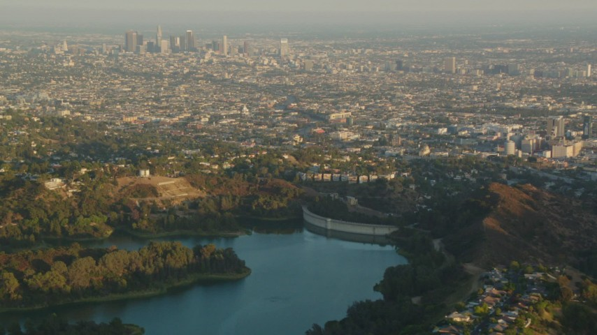 1080 stock footage aerial video Downtown Los Angeles skyline at sunset seen from the Mulholland Dam in the Hollywood Hills, California Aerial Stock Footage | HDA06_07